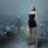 Futuristic woman in night city Stock Photo