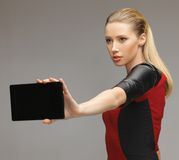Futuristic woman with tablet pc Stock Image