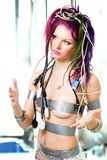Futuristic woman tangled in cables Royalty Free Stock Photography