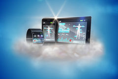 Futuristic wrist watch with tablet and smartphone on cloud Stock Photography