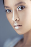 Futuristic young asian woman. Royalty Free Stock Images