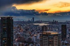 Futuristisk solnedgång i Osaka royaltyfri fotografi