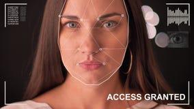 Futuristiskt och teknologiskt avläsa av framsidan av en härlig kvinna för ansikts- erkännande och den avlästa personen, framtid
