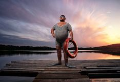 Fuunny overweight, retro swimmer royalty free stock image