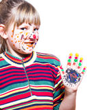 Fuuny little girl - colored hands and face Royalty Free Stock Photos