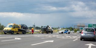 Fuzesabony, Hungary. Two cars are on the tow trucks after the accident on the road. Police blocked traffic. Broken glass royalty free stock image