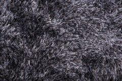 Fuzzy carpet. A fuzzy grey carpet background stock photos