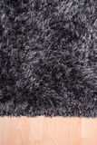 Fuzzy carpet lying on the floor Royalty Free Stock Image