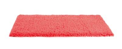 Fuzzy carpet on white background. Interior element stock photo