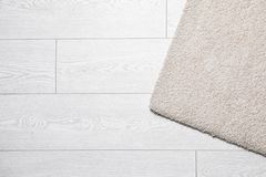 Fuzzy carpet on wooden background, top view. With space for text stock image