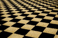 Fuzzy Checkerboard. Perspective of a fuzzy checkerboard carpet royalty free stock photo