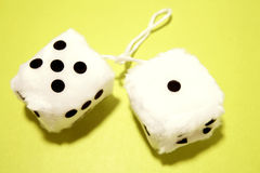 Fuzzy dice. On green background royalty free stock photography