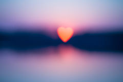 Fuzzy heart-shaped sun Royalty Free Stock Images