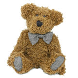 Fuzzy Stuffed Teddy Bear. A stuffed bear wearing a bow tie and isolated on white Royalty Free Stock Photo