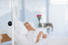Fuzzy view of  patient lying on her bed Royalty Free Stock Photo