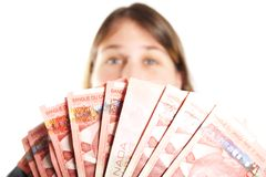 Fuzzy Woman Holding Fifties. Out of focus woman holding Canadian Fifty dollar bills Stock Image
