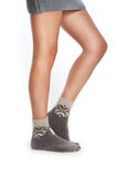 Fwmale legs in woolen socks Royalty Free Stock Photography