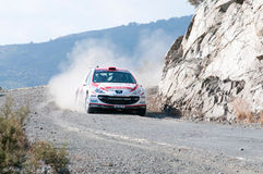 Fx Pro Cyprus Rally. Love Cyprus Stage. 2010. LIMASSOL, CYPRUS - NOVEMBER 7: Driver Burku Cetinkaya (tr) and co-driver Cicek Guney (tr) driving Peugeot 207 S2000 Royalty Free Stock Image
