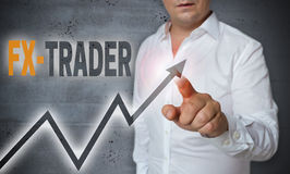 Fx trader touchscreen is operated by man Royalty Free Stock Images