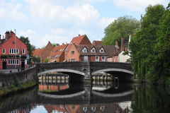 Fye Bridge, River Wensum, Norwich, England. The riverside with its old houses near Fye Bridge over the River Wensum in Norwich, England royalty free stock images