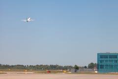 Fying away plane Royalty Free Stock Image