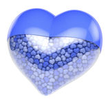 Fyllde den blå hjärta formade preventivpilleren, kapsel med små mycket små hjärtor som medicin Arkivbilder