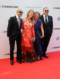 Fyodor Bondarchuk, Alexander Rodnyansky with wives Stock Photography