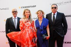 Fyodor Bondarchuk, Alexander Rodnyansky with wives Royalty Free Stock Image