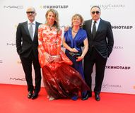 Fyodor Bondarchuk, Alexander Rodnyansky with wives Royalty Free Stock Photos