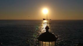 Fyr i solnedgången arkivfilmer