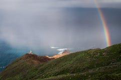 Fyr och regnbåge Arkivbilder