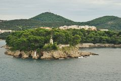 Fyr på ön av Daksa, Kroatien Royaltyfri Bild