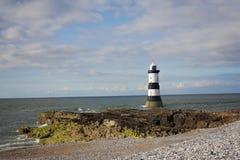 Fyr på Anglesey Wales Arkivfoton