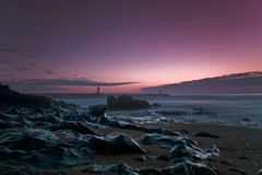 Fyr på solnedgången Fotografering för Bildbyråer