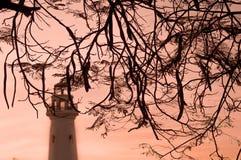 Fyr på solnedgången arkivfoton