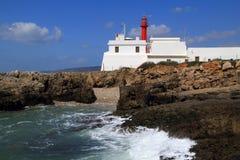 Fyr på udde Raso, Cascais, Lissabon Arkivfoto