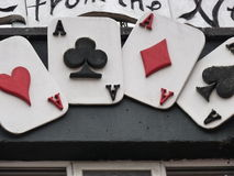 Fyra Ace av spadar på en vägg arkivfoton