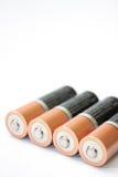 Fyra alkaliska batterier för motorförbundet på en vit bakgrund Royaltyfria Bilder
