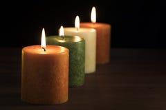 Fyra Autumn Candles Fotografering för Bildbyråer