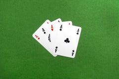 Fyra av en sort gör ett ess på poker, Arkivbild
