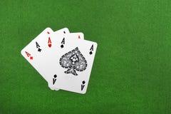 Fyra av en sort gör ett ess på poker, Royaltyfri Foto