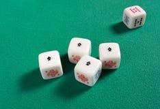 Fyra av en sort på pokertärning Arkivfoto