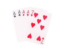 Fyra av en sort som spelar kort som isoleras på vit bakgrund Arkivbild