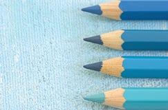 Fyra blåa blyertspennor Arkivbilder