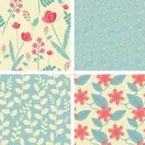 Fyra blom- seamless mönstrar Arkivfoton