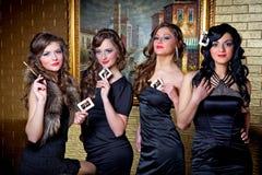 Fyra drottningar av poker Arkivfoto