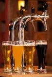 Fyra exponeringsglas av öl Arkivfoto