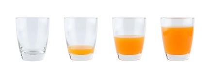 Fyra exponeringsglas av orange fruktsaft Royaltyfri Foto