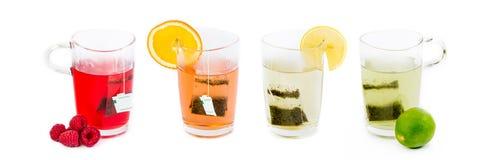 Fyra exponeringsglas med fruktte - olika smaker, olika färger Royaltyfri Foto