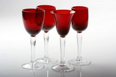 fyra exponeringsglas rött vin Arkivbilder